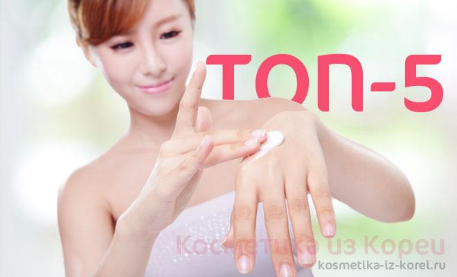 кореянка наносит крем на руки